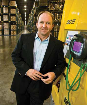 <p>Del Monte relies on more than 30 fork-equipped AGVs for put away and pallet picking in the distribution center. <i>Pictured: Keith Arntson, vice president of distribution operations for Del Monte Foods.</i></p>