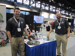 <p>Zach Norkey, southeast territory manager, and Mike Kulka, national account manager, show off Caster Concepts&#8217; new ErgoMaxx and TWERGO casters.</p>