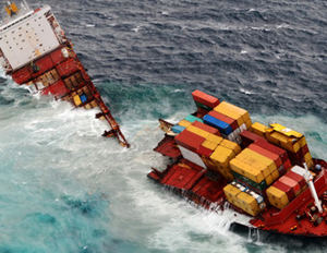 <p>The container ship Rena is seen in two pieces after overnight bad weather pounded the vessel near Tauranga, New Zealand on Sunday. <i>Maritime New Zealand via <a href=