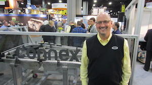 <p>Bruce Gray, Hytrol's Connex product manager, explained the company's new plastic chain conveying systems in an in-booth presentation on Tuesday.</p>
