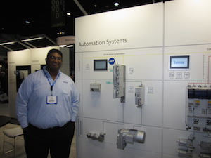 <p>Joel Thomas, Lenze OEM Consultant for Intralogistics with the company&#8217;s new solutions for drive-based and controller-based automation.</p>
