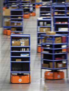 <p>Mobile robots deliver the modules to the conveyor system</p>