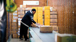 <p>Simon &amp; Schuster relies on extendable conveyors to receive floor-loaded trailers.</p>