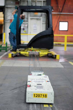 <p>Automatic guided vehicles engage specially-designed frames to transport cabs through the assembly process.</p>