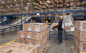 <p>In the receiving department, cartons are palletized for putaway in a very narrow aisle reserve storage area.</p>