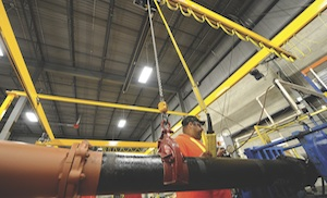 <p>A workstation lifting system takes the load off workers at a water distribution products supplier.</p>