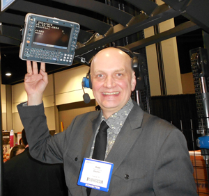 <p>Hidde Hanenburg, Intermec product manager for vehicle mount computers, with the new CV41 vehicle mount computer. He also is wearing Intermec's VoCollect voice system, which integrates with the computer, permitting voice for normal workflow, and the computer for exception handling.</p>