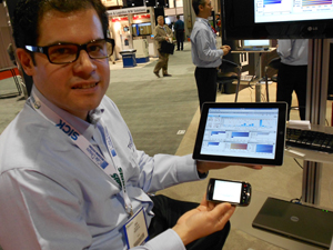 <p>Dino Stamatiou, TECSYS product director for business intelligence, shows mobile devices running the new mobile BI app.</p>