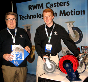 <p>RWM Casters' president Peter Comeau (left) and sales engineer Mike Twitty display heavy duty casters.</p>