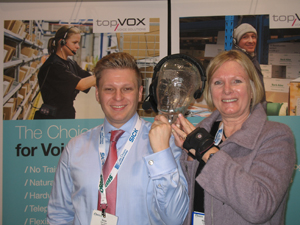 <p>Stefan Saettele, international sales manager for topVOX (left) and Marceline Absil, VP of marketing and sales, put their heads together with Lydia, the company's voice technology solution.</p>