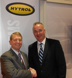 <p>Hytrol president Gregg Goodner (left) and Thomas Dalstein, president and CEO of Beumer Group, at the Hytrol booth Monday.</p>