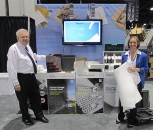 <p>Lew Smith, Global Product Line Director, and Jaime Shackleford, Product Line Manager for Sealed Air (Booth 2709) show off some of the company's new protective foam packaging lines.</p>