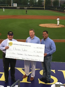 <p>(left to right): Jim Cieslar, executive director of United Way of Pitt County, accepts a check for $6,250 from Thom Peebles, NMHG Director, Brand Management and Mike Moran, NMHG Director, Warehouse Product Sales, atop the ECU dugout on Tuesday.</p>