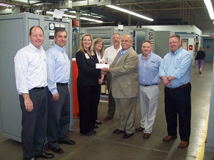 <p>George Ardolino, AMETEK Division vice president/business unit manager, (center) presents $25,000 scholarship fund check to Vera Fosnot, Ohio State University Industry Liaison Director. Also pictured from left: Steve Wetta, director of engineering and administration; Bogdan Proca, director of R&amp;D; Susan Midel, director of HR; Nick Yarnell, contracts manager; Jim Lichtenberg, business manager of Prestolite Power; and Jason Cotton, global director of sales and service.</p>