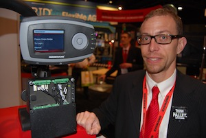 <p>Scott Craver, product manager of business and information solutions for The Raymond Corporation, demonstrates the color screen of the iWarehouse hardware.</p>