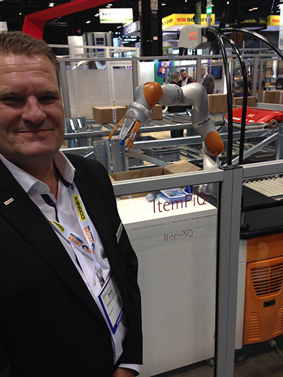 <p>Markus Schmidt, president of Swisslog WDS Americas, pointed out Swisslog's AIP robot picking a variety of small items</p>