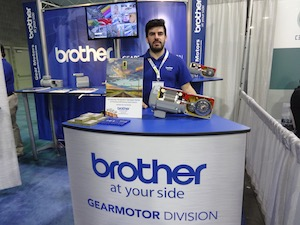 <p>Juan E. Avalos, Applications Engineer, shows Brother Gearmotors' conveyor series line</p>