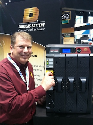 <p>Brian Faust, GM of Douglas Battery, with the Raptor Rapid charger in a three-bay model. A larger six-bay model also was on display.</p>