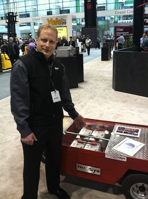 <p>Chad Uplinger, GM of specialty markets for EnerSys, with a NexSys battery system installed in a sample burden carrier at the EnerSys booth.</p>