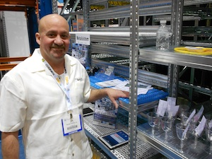 <p>Steve Rogers, VP of sales for Hannibal Industries, with some of Metalsistem's highly configurable shelving systems.</p>
