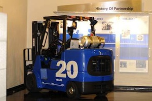 <p>To honor the occasion, 69 employees who have worked at MCFA for its full 20 years signed a commemorative forklift. The forklift, which also features a special decal signed by all MCFA employees, will be displayed in the company's headquarters building and will later be used throughout MCFA's manufacturing operations to move materials in fabrication and assembly.</p>