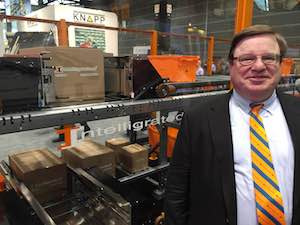 <p>Chris Cole, CEO, Intelligrated, and the OLS shuttle system.</p>