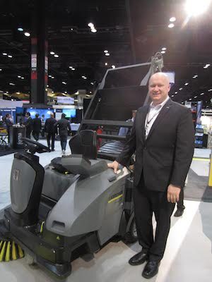 <p>Steve Bowie, EVP of sales, with the KM 105/110 emissions-free ride-on floor sweeper</p>