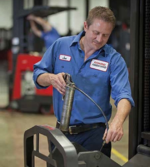<p>Routine lift truck maintenance includes regular oil applications.</p>