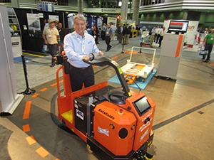<p>James Bradshaw, president &amp; CEO of AutoGuide, a Heartland Co., demonstrates the TVM5K tugger.</p>
