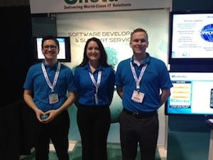 <p>In front of the Chetu booth, Michael Branton, national account manager, retail; Jane Powell, global sales director, retail, supply chain and strategic solutions; and Charles Caldwell, national account manager, supply chain.</p>