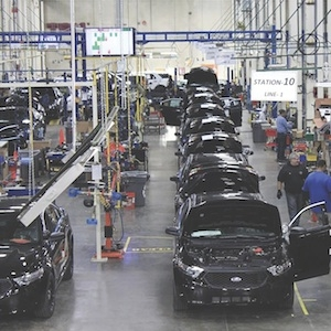 <p>Troy Design &amp; Manufacturing (TDM) uses RFID technology to automatically capture work-in-process data at its Chicago facility. The plant modifies Ford vehicles for police use.</p>