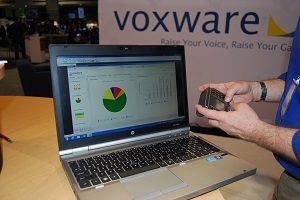 <p>Keith Phillips, CEO, Voxware, demonstrates the VMS dashboard and a mobile terminal.</p>