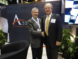<p>John A. Caltagirone, founding director, Supply and Value Chain Center, Quinlan School of Business (left) and Mike Romano, President/CEO of Associated and Peach State Integrated Technologies (right)</p>