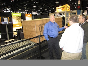 <p>John Wylie, director of sales and applications for SafeFlo, showcasing the SafeFlo technology for the storage and controlled gravity flow of slip-sheet and other pallet-less load applications.</p>