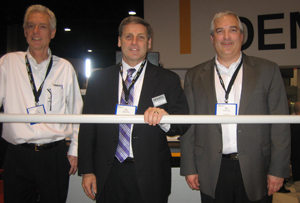 <p>From left: Ken Ruehrdanz, distribution market manager; Mike Khodl, vice president of solution development; and John Baysore, president and CEO, demonstrate the new piece picking capabilities of Dematic's RapidPick system.</p>