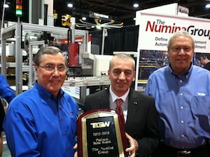 <p>Dan Hanrahan (left), president of Numina Group, is presented with TGW's Platinum Sales award by Mario Herndl (center), president of TGW. Also pictured in Jim Bronsema, director of sales with TGW.</p>