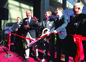 <p>Gregg Goodner, board member of Hytrol and VP and GM of MHI, cuts the ribbon to open Modex 2016.</p>