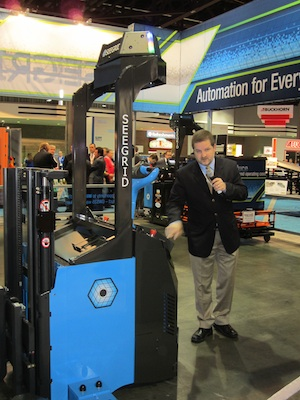 <p>Jeff Christensen, director of product development at Seegrid, demonstrates the new GWS35 automated, vision-guided walkie stacker.</p>