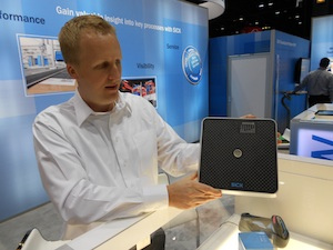 <p>Brian Orstad, a senior product manager with SICK, with the new RFU630 RFID Interrogator.</p>