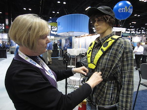 <p> Marceline Absil, VP of sales and marketing at topVOX shows how the new Lydia VoiceWear vest can be worn.</p>