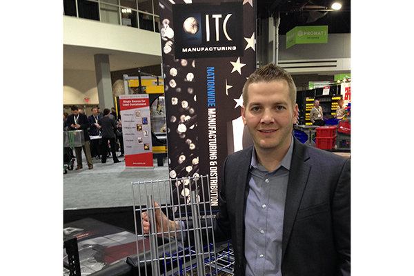 <p>Tyler Leintz, director of sales with ITC Manufacturing, holds a sample section of 1x4 inch grid pattern wire mesh with inverted channels, a type of wire mesh often used in the food industry because the inverted channels won't catch loose product.</p>