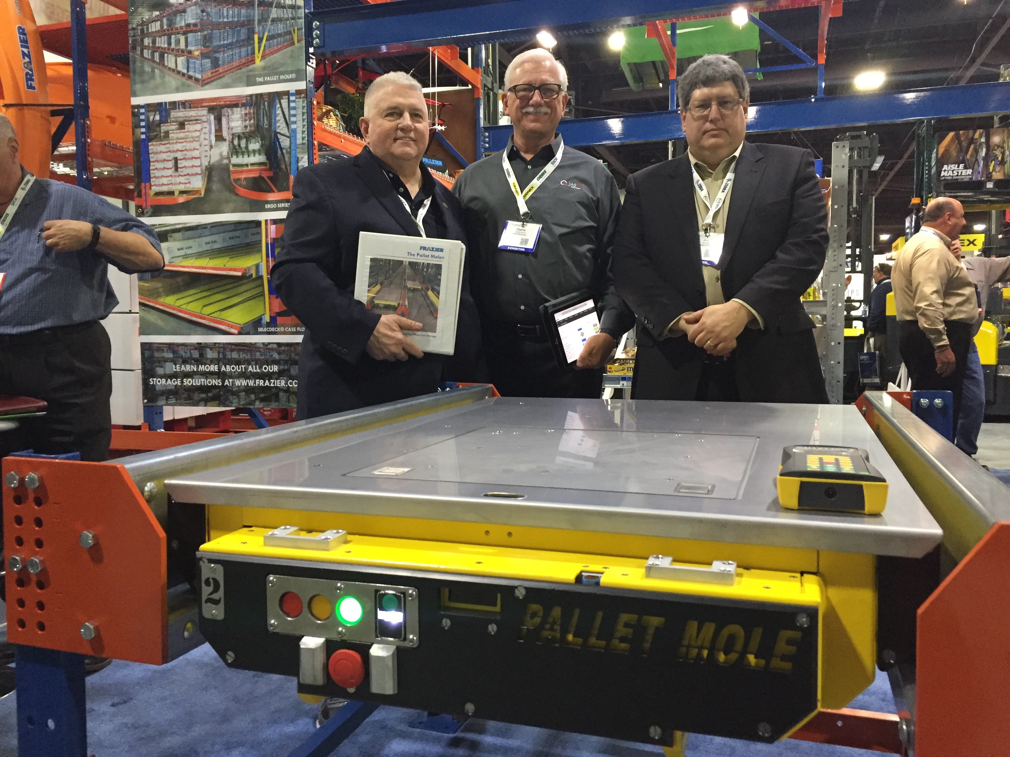 <p>Domenick Iellimo, EVP of Frazier Industrial, Charlie Armstrong, partner at JASCI Software, and Jim Kocsis, GM of Pallet Mole automation, showcase the latest rugged version of the Pallet Mole.</p>