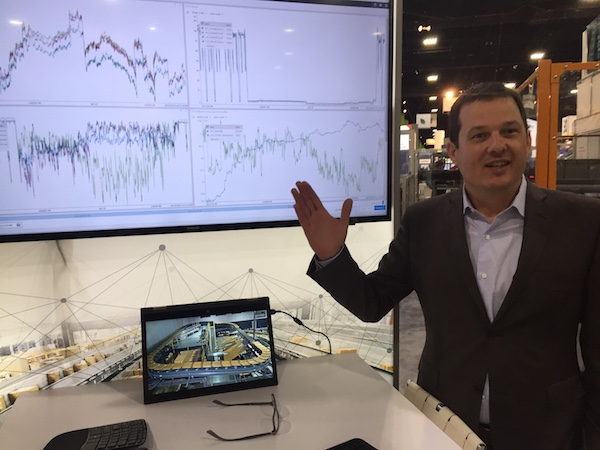 <p>Pieter Krynauw, president of Honeywell Intelligrated, demonstrates Momentum's real-time metrics and a live feed from a facility demonstration center.</p>