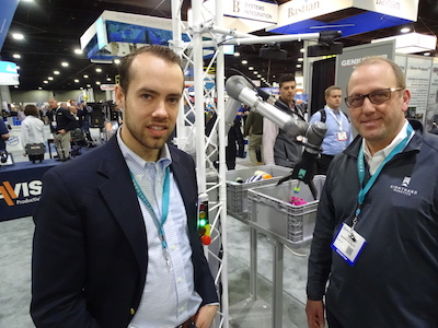 <p>Leif Jentoft, co-founder of Righthand Robotics (left) and Vince Martinelli, VP of business development, next to one of the collaborative robot picking stations at their booth.</p>