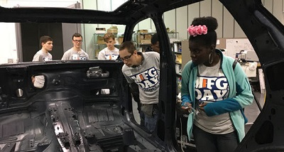 <p>Students from Oakland Schools&#8217; Technical Campus in Royal Oak visit Madison Heights auto supplier Henkel North America during Manufacturing Day in Oakland County last October. Henkel provides adhesive, sealant and protective coating technologies to the auto industry.</p>