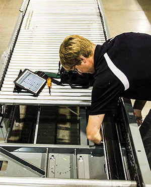 <p>A technician uses the dashboard on his iPad to pinpoint a conveyor repair point.</p>