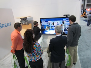 <p>Attendees watch a demonstration of Beumer&#8217;s Virtual DC Tool.</p>