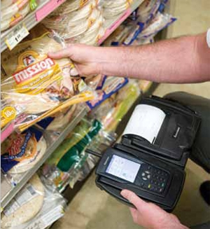 <p>An independent distributor uses a handheld computer with attached portable printer to wirelessly transmit delivery information to Mission Foods in real time and generate invoices at a grocery retailer's store.</p>