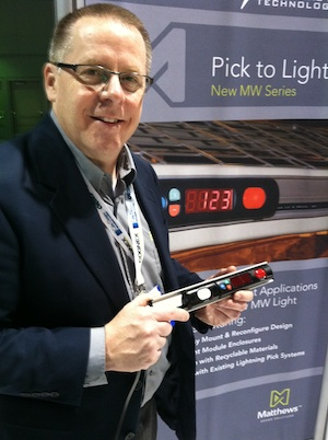 <p>Paul Jensen, division president of Matthews Marking and Fulfillment Systems, with the new MW Series Pick to Light Module, whose features include full module enclosure.</p>